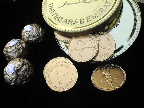 dubai and united arab emerites invest in clean technology image of money