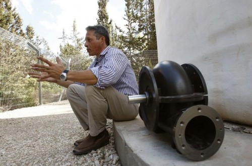 Leviathon's COO Gadi Hareli next to one of his company's water turbines