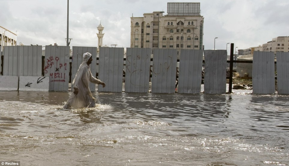jeddah floods sewage saudi arabia photo man streets walking