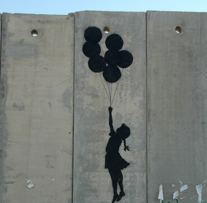 west bank palestine wall security photo graffiti girl balloons