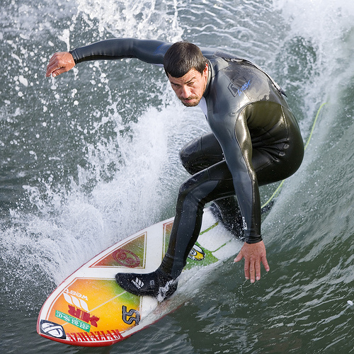 surfer on board riding wave image
