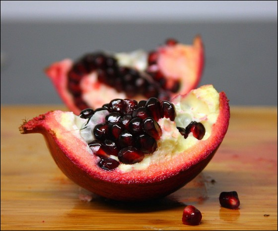 blood red seeds in open pomegranate