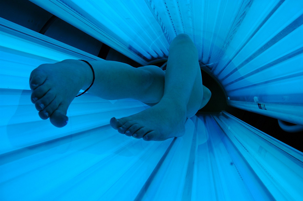 How Moms Risk Their Daughters' Health: The Inheritance of Tanning Hazards