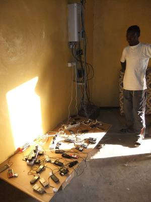 Ethiopia's New Solar-Powered Cell Phone Charging & Water