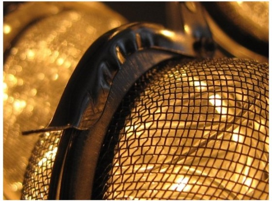 Recycled tea strainer lamp creates soothing glow green prophet - Recycled light fixtures ...
