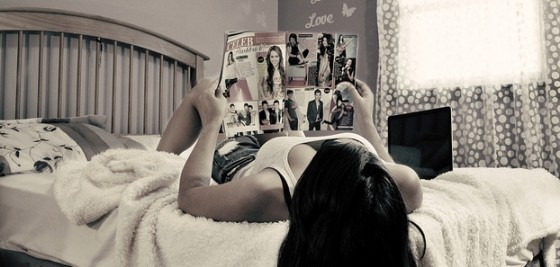 teen reading magazine