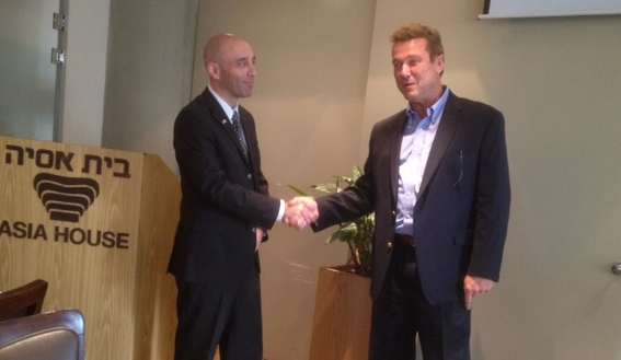 Shaul Zemach (left) shakes hands with Zvi Rome of Petco (right) at the Asia House in Tel Aviv this Tuesday morning