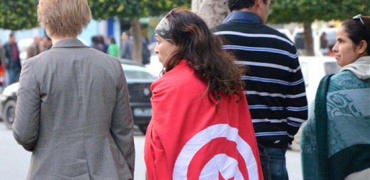 Tunisian-Woman-Wrapped-in-Flag.jpg
