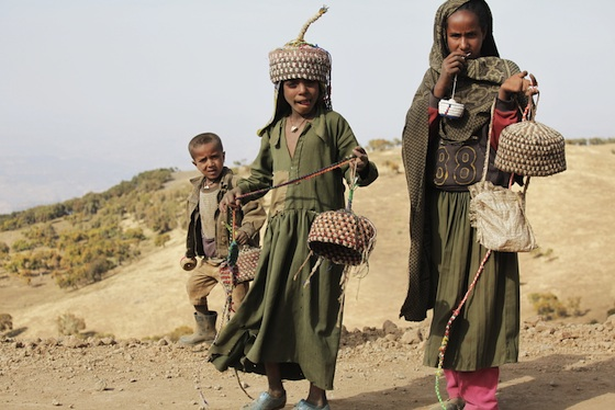 Ethiopia children carrying water
