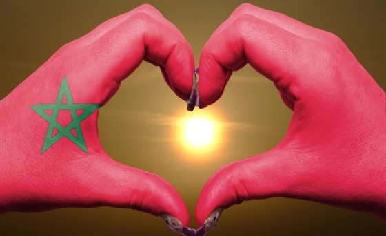 morocco sun, hands, moroccan flag, renewable energy
