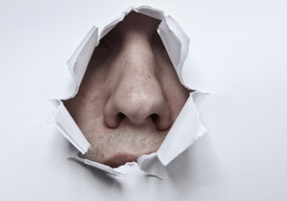 white smell nose breaking through paper