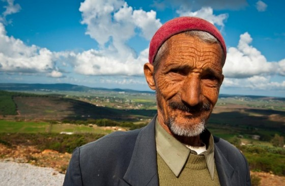 arab man red hat in nature