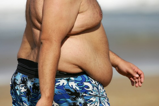fat man belly on beach