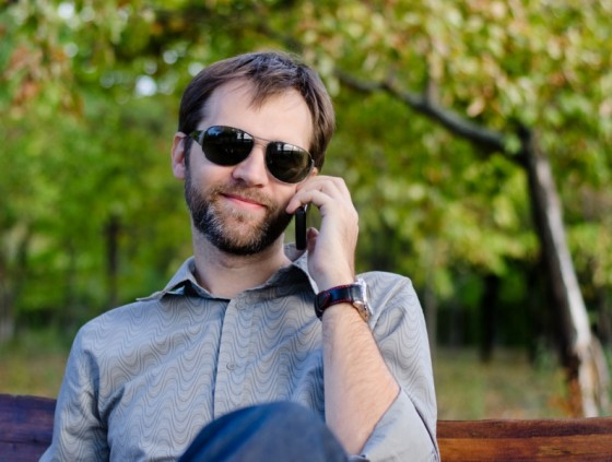 cell phone user with sunglasses, cancer