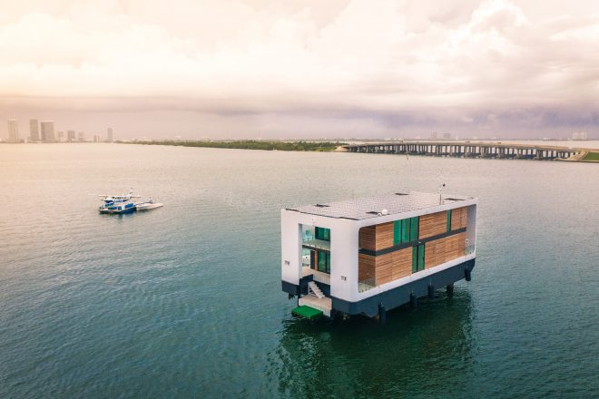 fly in with your helicopter to this solar powered house boat