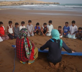 Children in a surfing lesson.