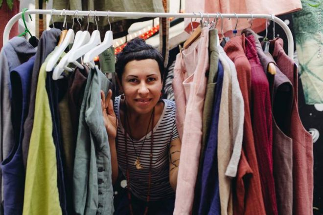 Nina Skibnevsky in a pile of clothes made from hemp