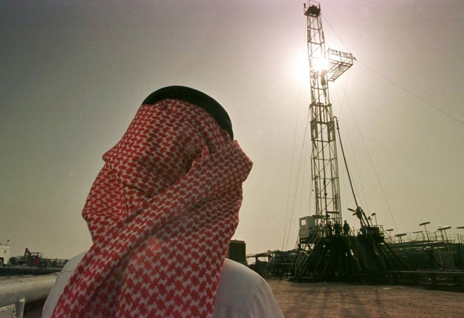 Khaled al Otaiby, an official of the Saudi oil company Aramco watches progress at a rig at the al-Howta oil field near Howta, Saudi Arabia, on Feb. 26, 1997. Energy is the big strand in a web of U.S.-Saudi economic ties that has grown in the six years since an American-led army rolled back Iraqi aggression in the Persian Gulf.