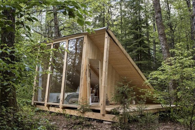 a frame cabin, solar in the woods