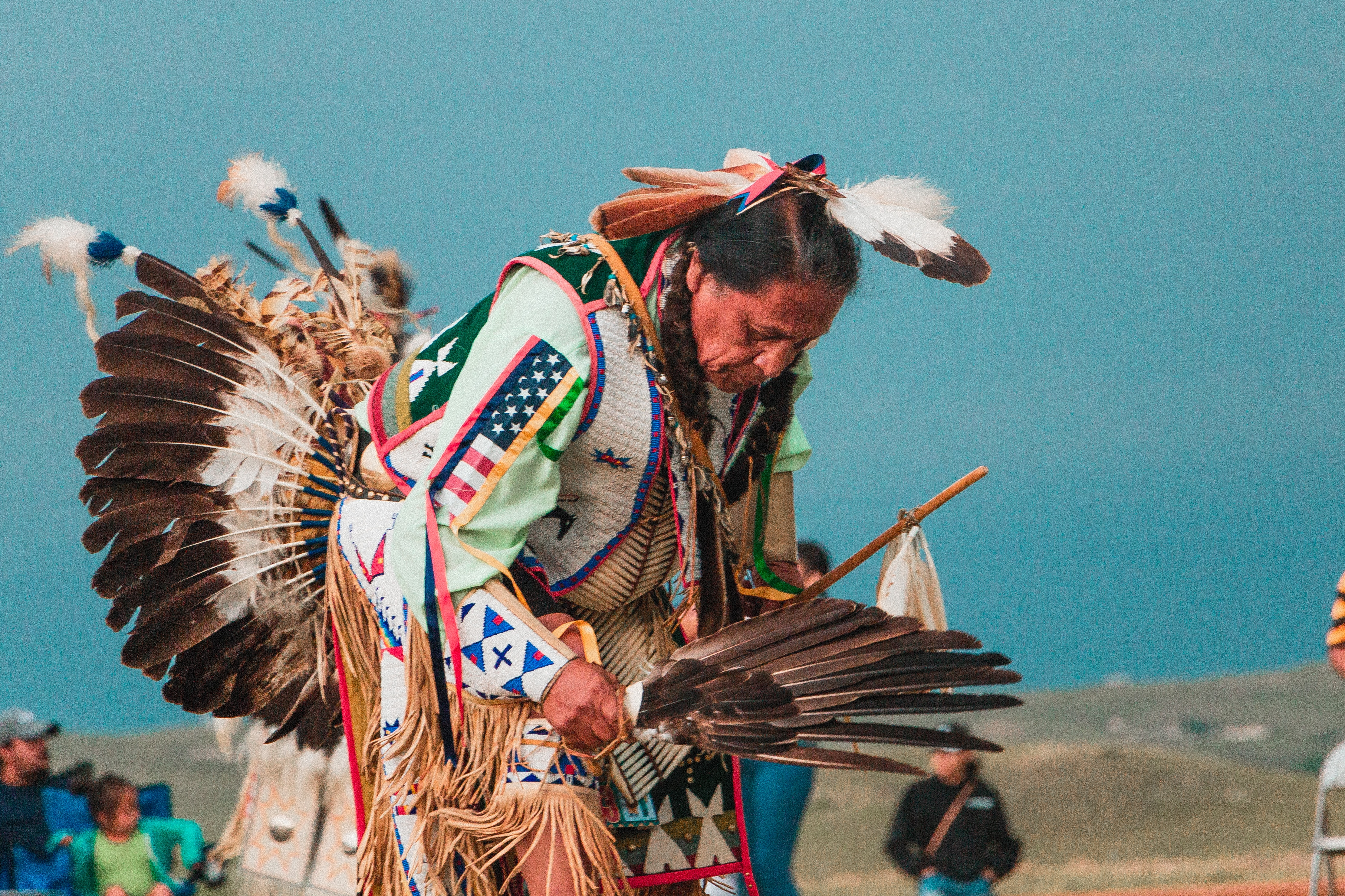 first nations man dancing in traditional costume