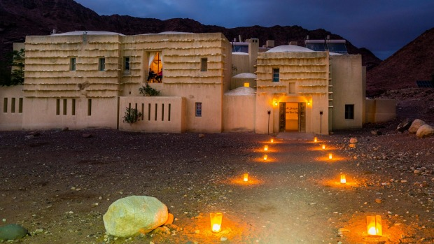 eco hotel lit by candles