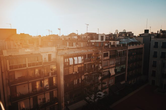 sun on roofs of apartments in barcelona