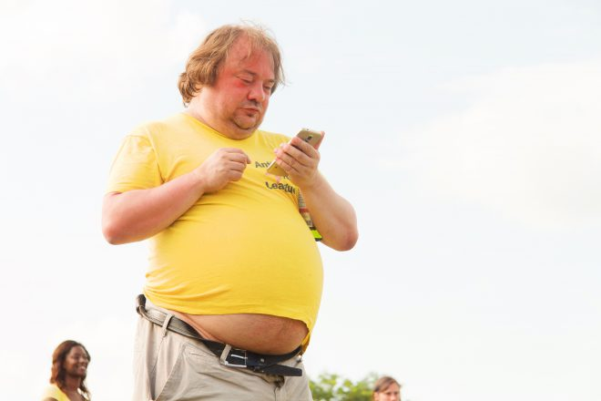 man in yellow shirt, huge tummy sticking out