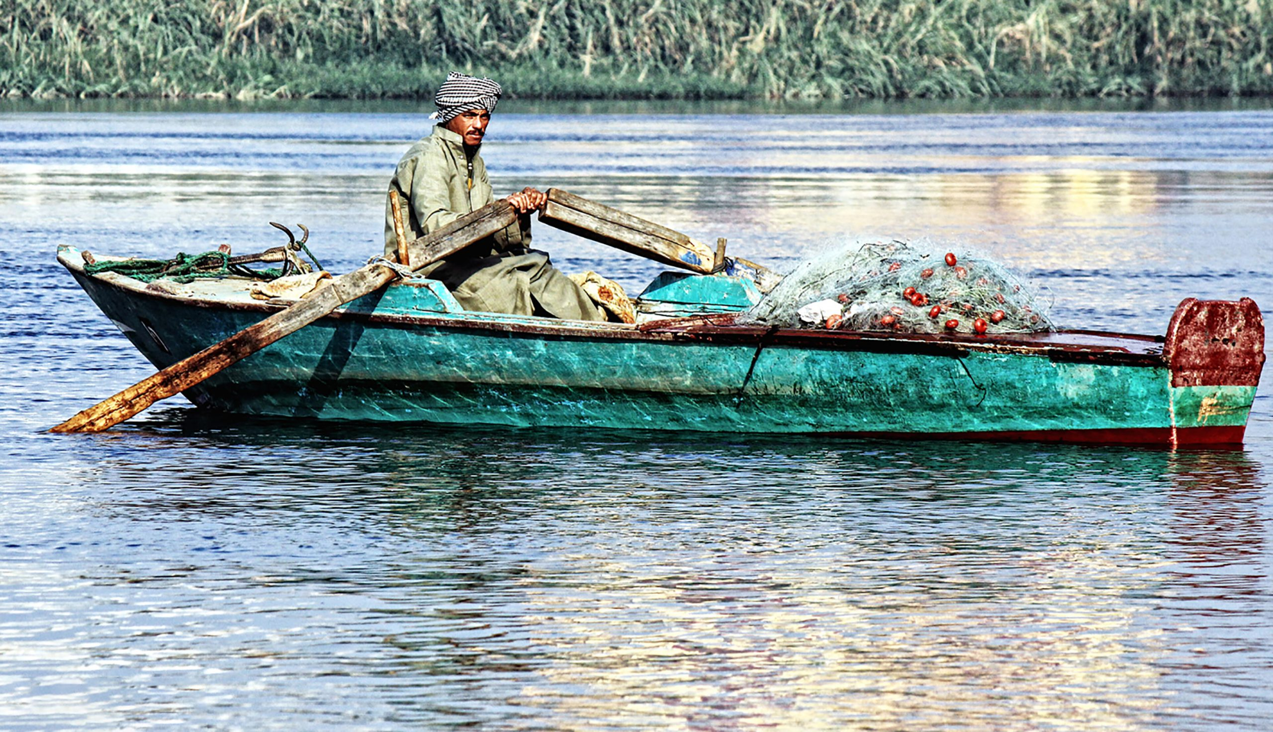 man on boat nile river