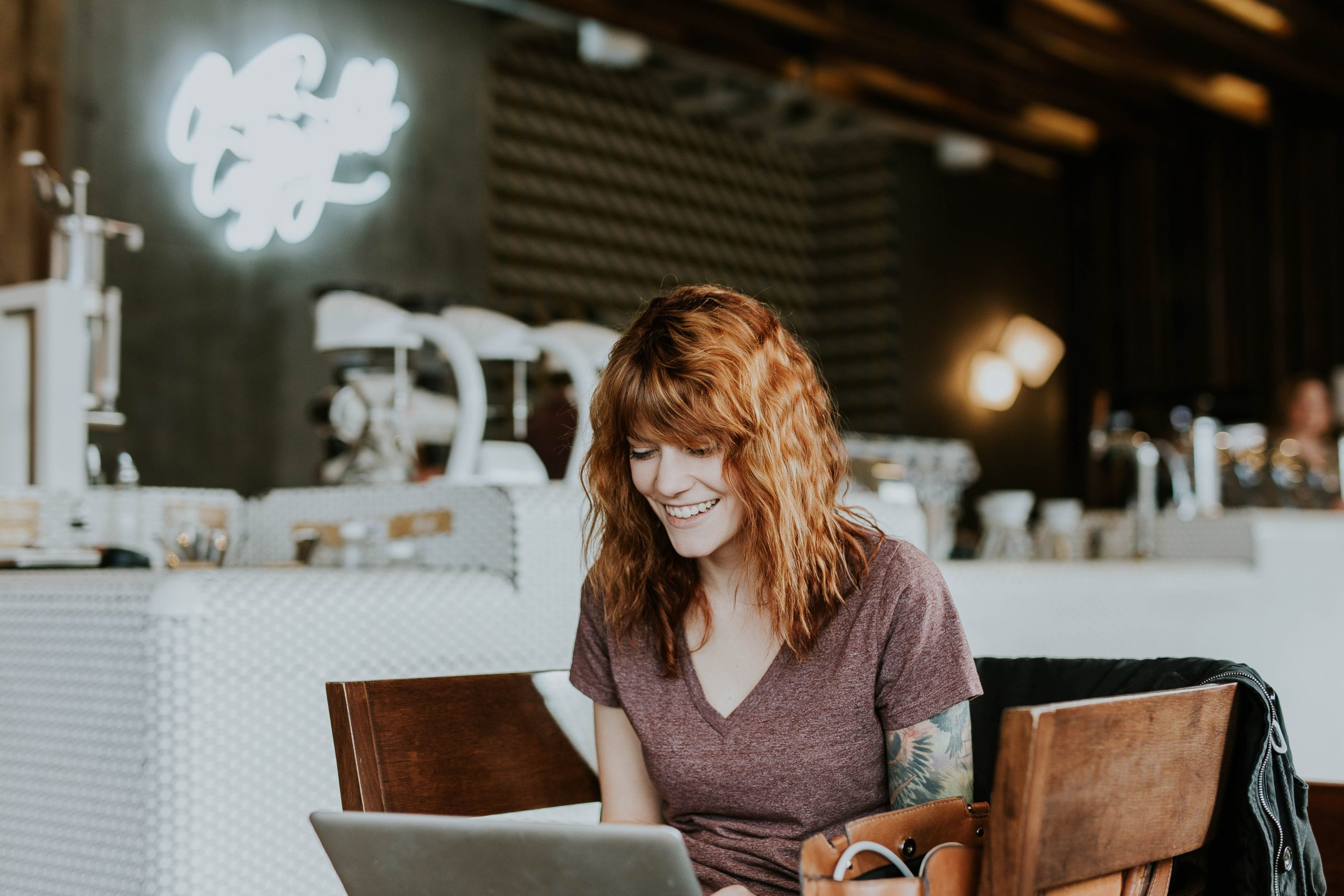 woman working at wework on her laptop