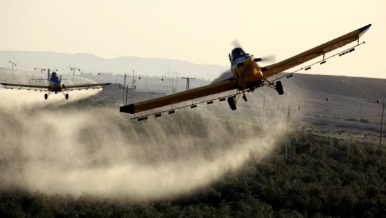 spraying pesticides by plane