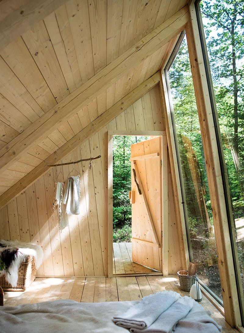 stedsans cabin in the woods, inside view, wood windows