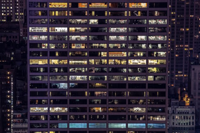 windows of office buildings at night new york
