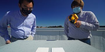 white reflective paint, researchers look at samples
