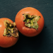 a pair of persimmons